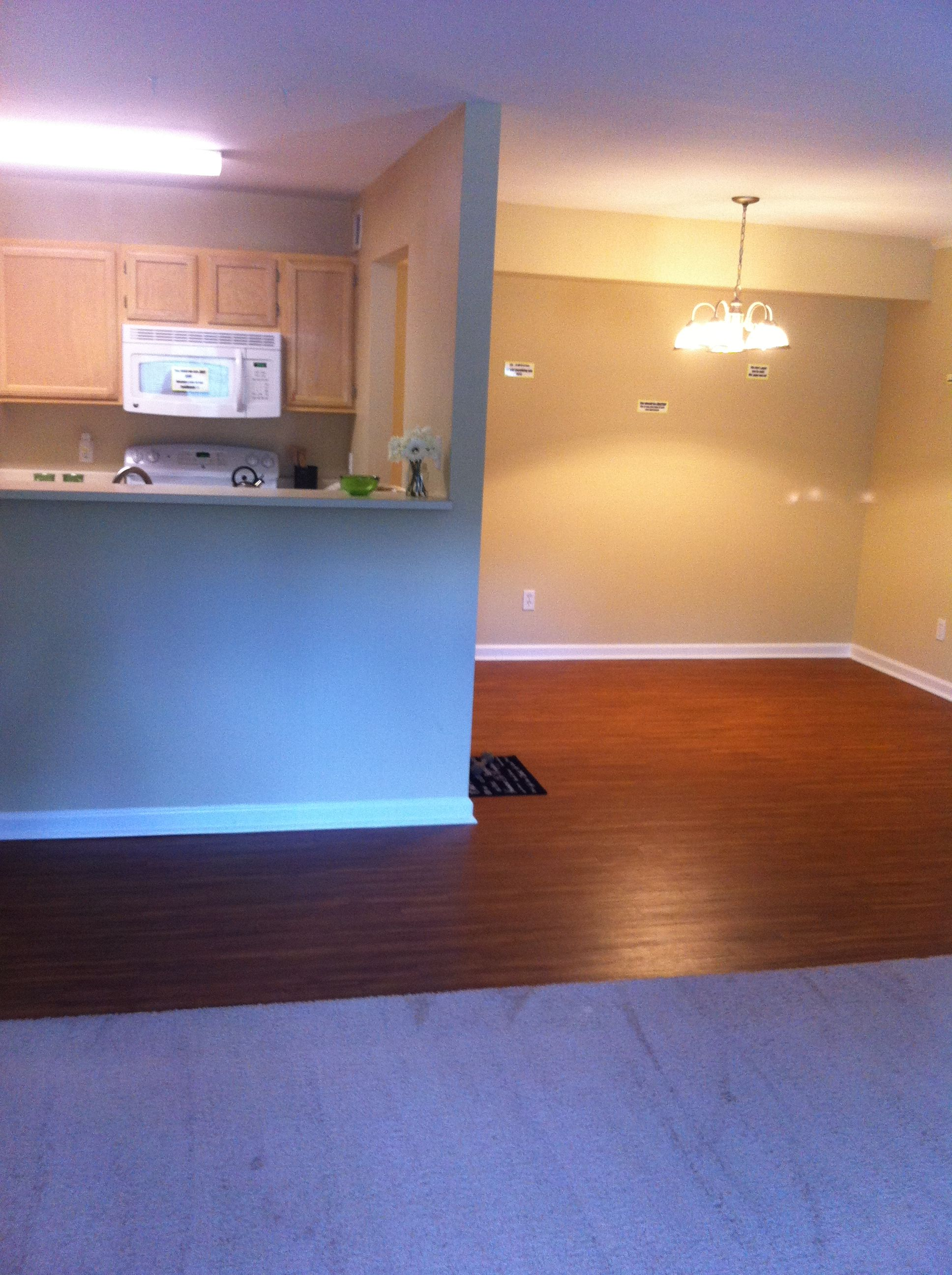 The 1/1 kitchen and dining area. The apartment pictured features our plank flooring.
