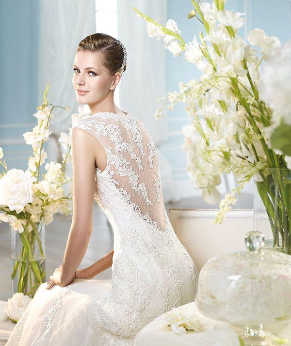 escotes a la espalda cubierto de delicado encaje · vestido de novia