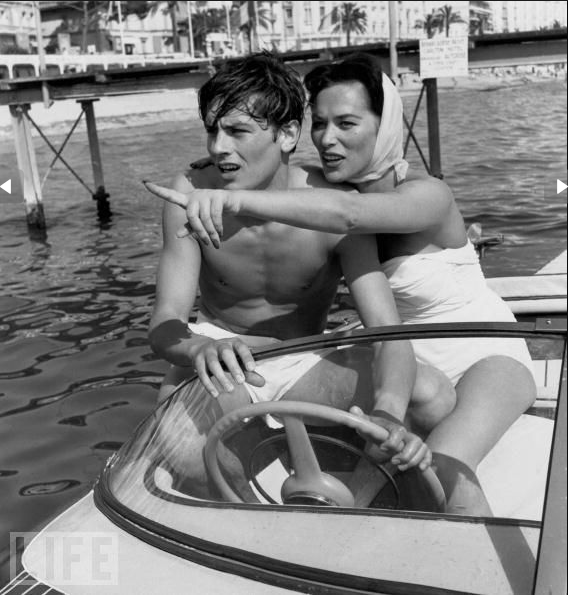 83c10ed312852 Alain Delon and Bella Darvi go boating during the Cannes Film Festival on  May 5