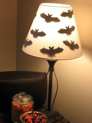 Bat shapes taped inside a lampshade create a fun Halloween look - create halloween decorations