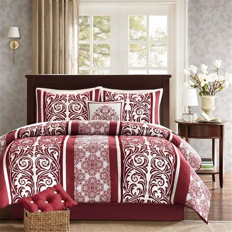 Give your bedroom an updated look with the Sierra collection. The comforter and sham features a beautiful red and white scroll and geometric prints that is mixed with stripe details to give a updated vertical layout pattern. The pattern is printed on microfiber with motifs that are flocked to give dimensional and textural feel to the collection. The set includes a taylored red microfiber bedskirt. The set also includes two decorative pillows to complete the whole look.
