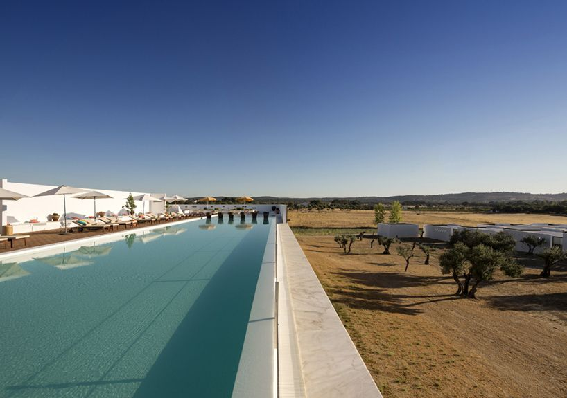 Portuguese hotel by José Carlos Cruz is clad with cork facades - via designboom 25.08.2014   One hour outside of lisbon, in the portuguese region of évora, architect josé carlos cruz has completed a spa and resort complex clad with a natural brown cork. the project, named the 'ecork hotel', boasts 56 private residences, fine dining facilities, and a spa and gym complex.