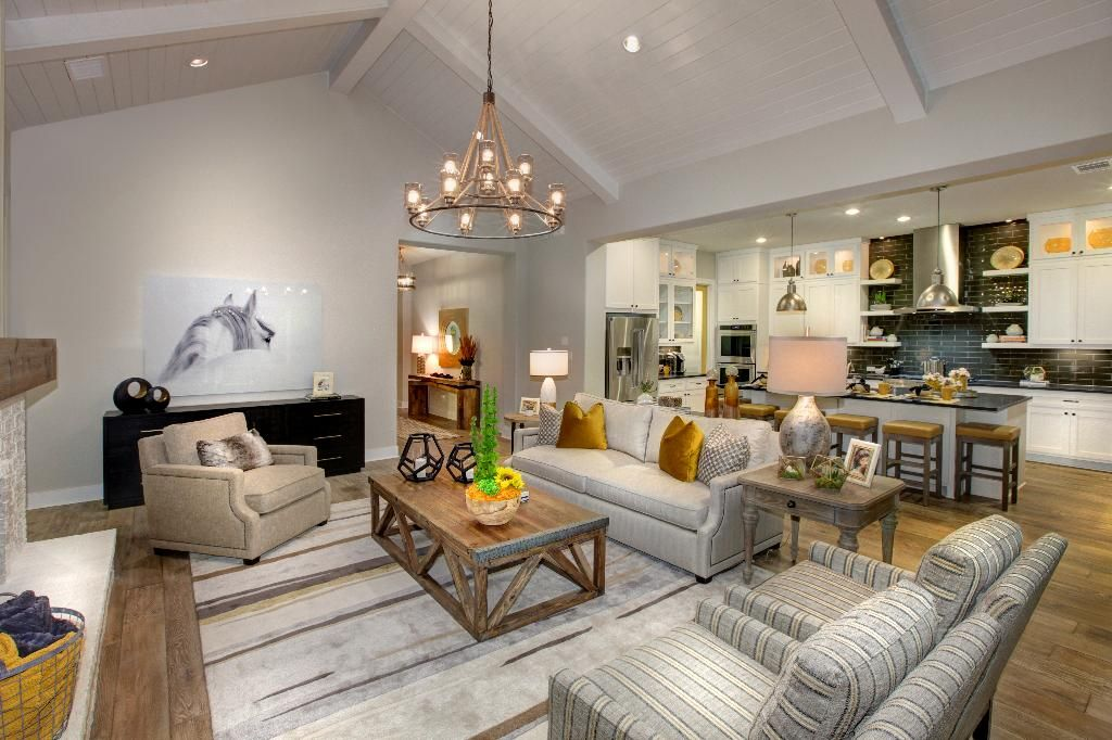 Family room with vaulted ceiling and distressed hardwood floors; The Tinsley floor plan, Drees Custom Homes, Austin