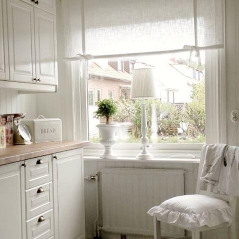 Swedish log cabin with white interior