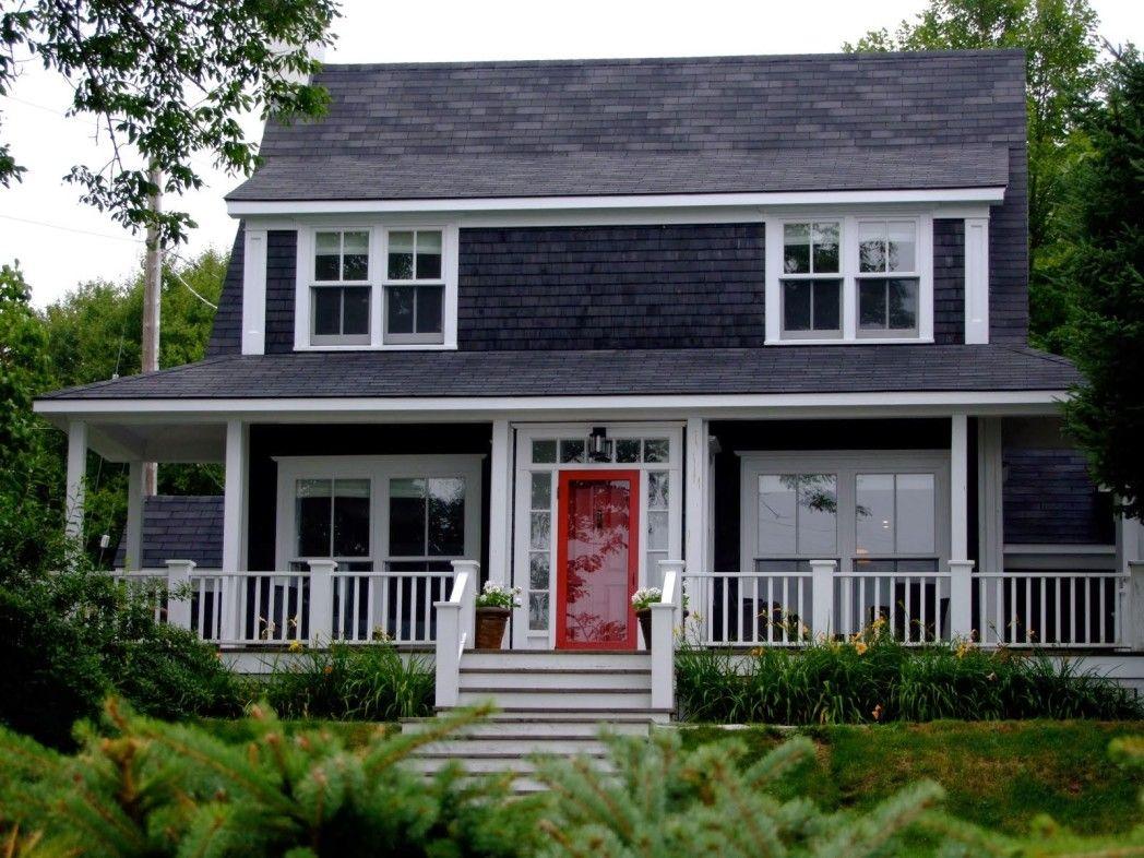 Grey house black garage doors - House