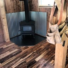 Oh And The Wood Stove Is In Pacific Energy T4 Looking Classy Af With The Flooring Choice And The C Wood Stove Wall Wood Stove Decor Wood Stove Heat Shield