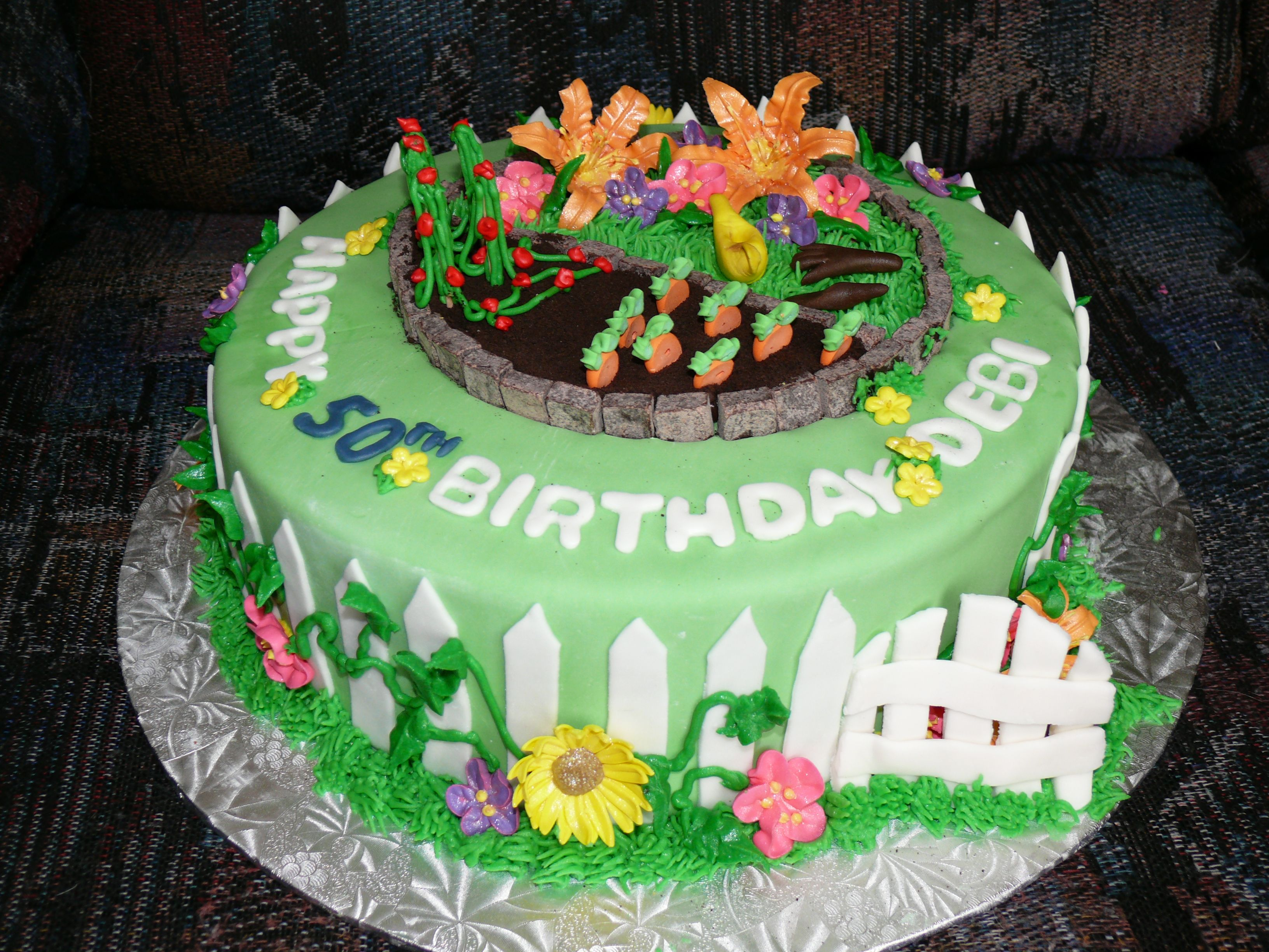 Garden themed 50th birthday cake. One layer chocolate, one layer ...