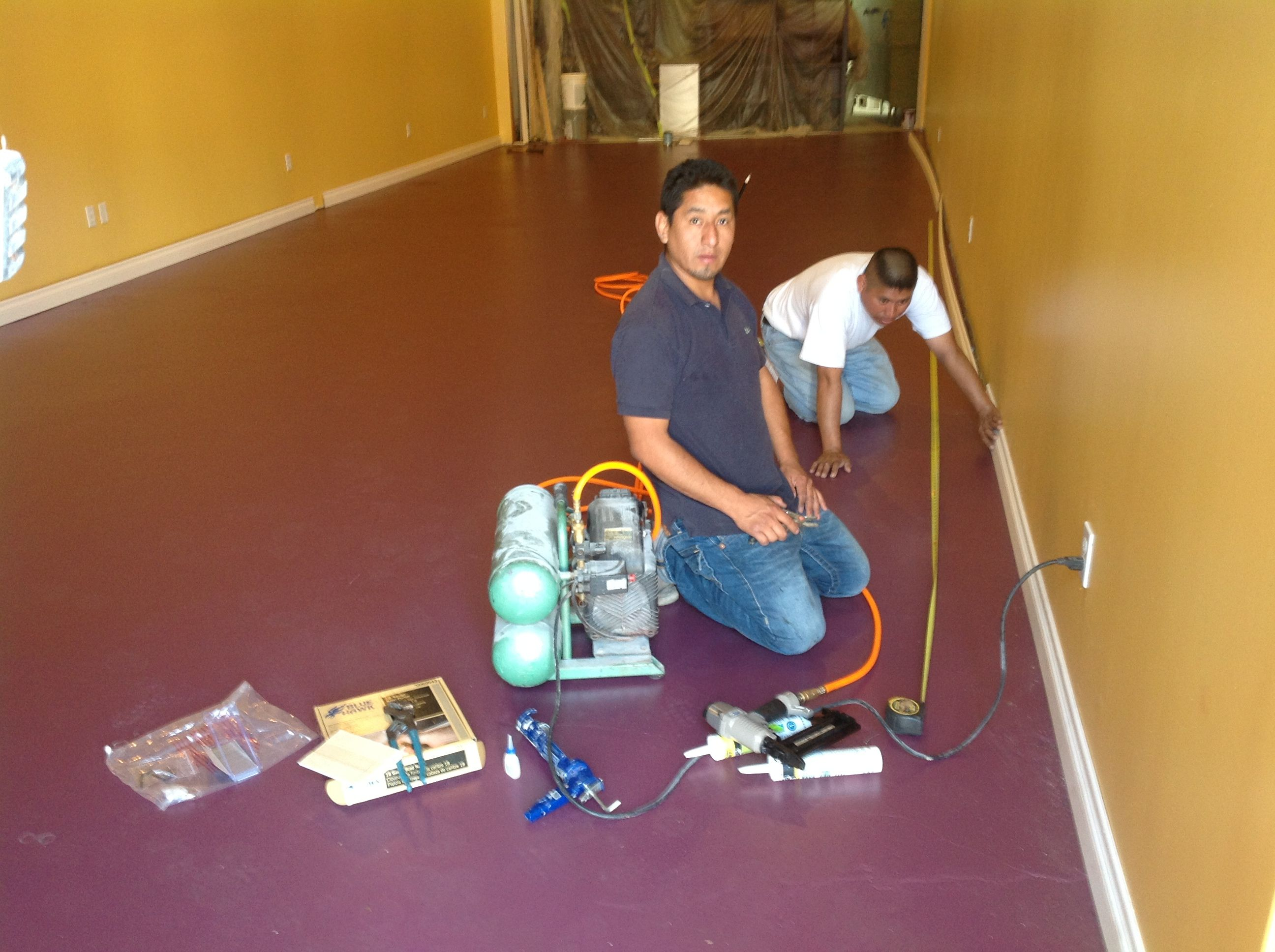 February 2013.  Jesse paints the walls and lays down crown molding and floor boards.