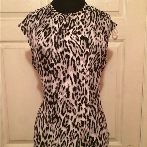 BUNDLEAnimal/Geometric Print Blouses (2) Pre-Owned Worthington Animal Print and Geometric Sleeveless Print tops.  Size: Large and in Excellent Condition.  The blue and yello and white top has a split neck and the animal print has a pleated front.  100% Polyester Worthington Tops Blouses