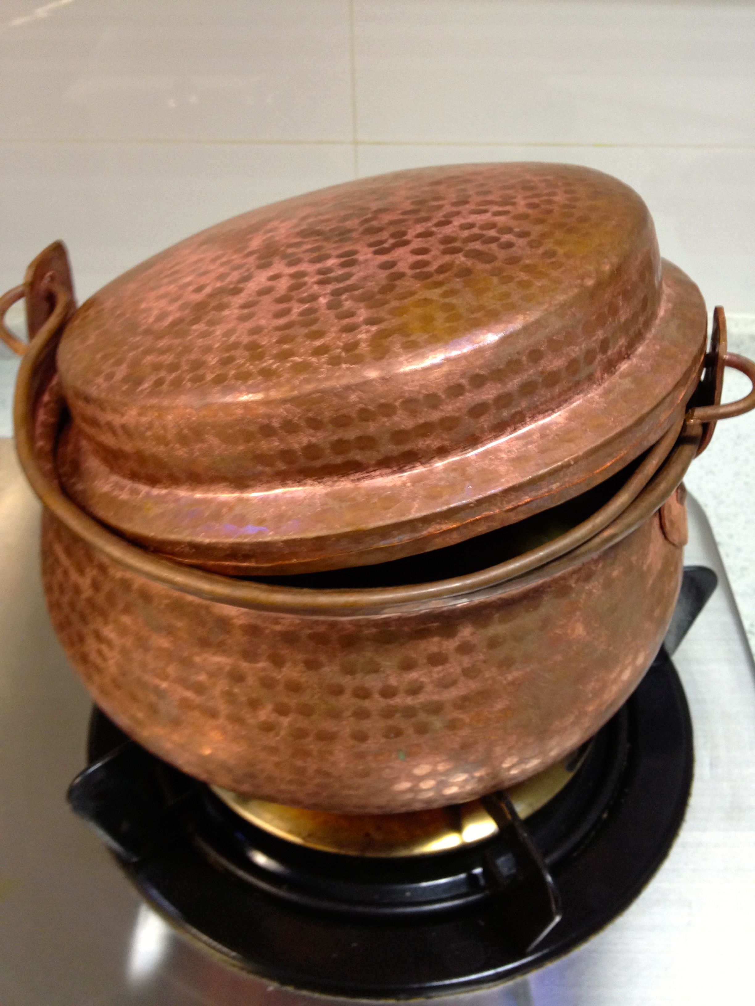 Yunnan Copper Pot famous around FuXian Lake. Recipes include Copper Pot Rice and Copper Pot Fish (fresh water fish from FuXian Lake)