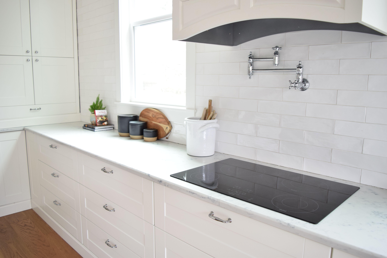 White Modern Farmhouse Kitchen With Wavy White Subway Tile