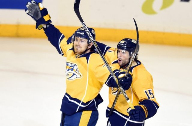 Colin Wilson (left) scored the first of two Predators goals over a 12-second span. (USATSI)