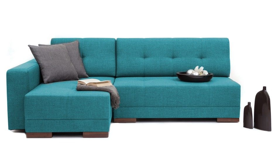 A wraparound couch that converts into a double bed with a