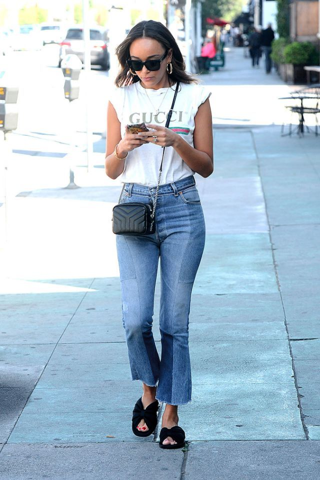 9a58d5410c92d English actress Ashley Madekwe paired her cropped denim with the white T- shirt and a black crossbody bag. (Photo  Splash News)