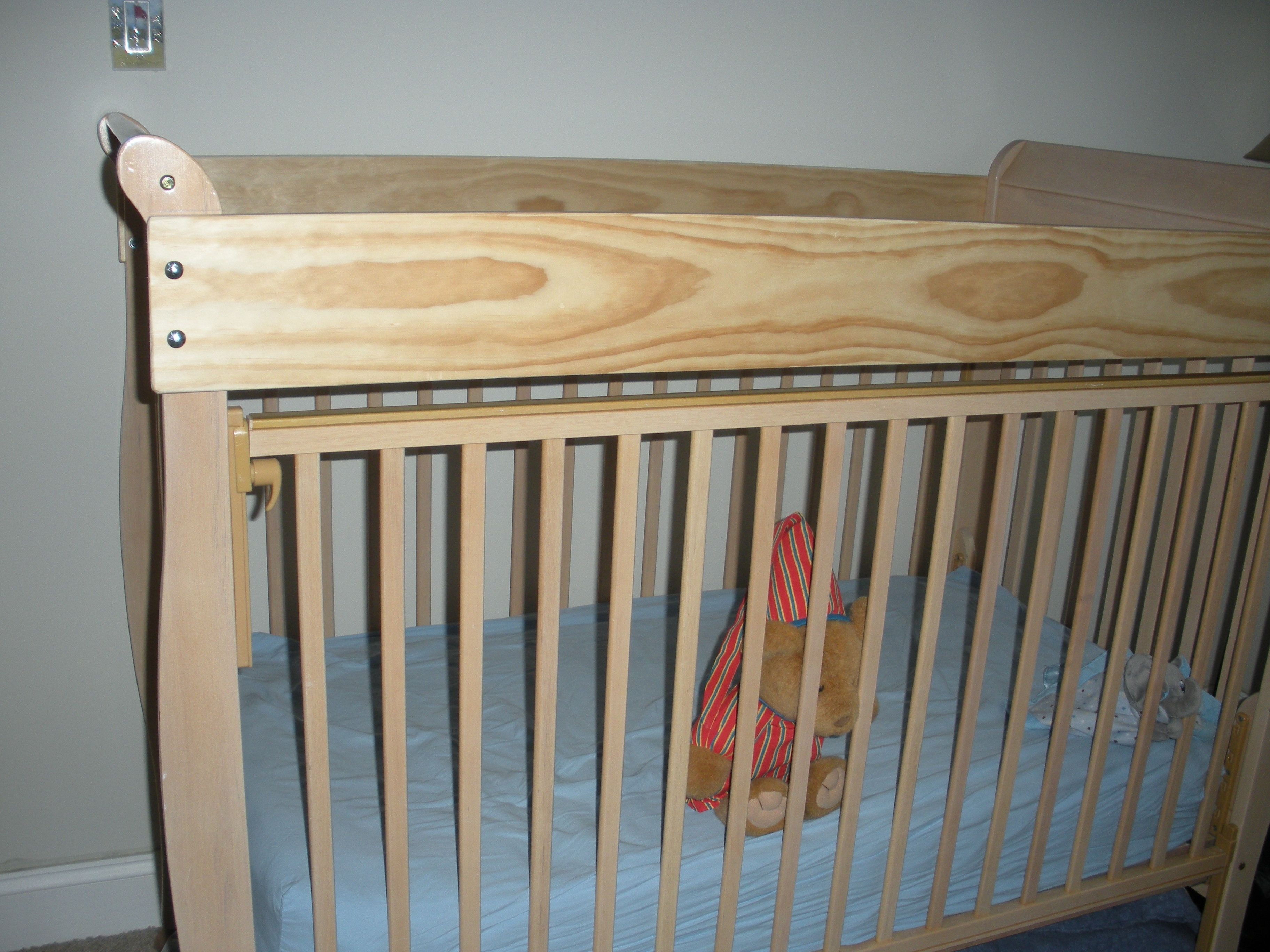 To keep toddler in crib as long a possible, attach an Oak