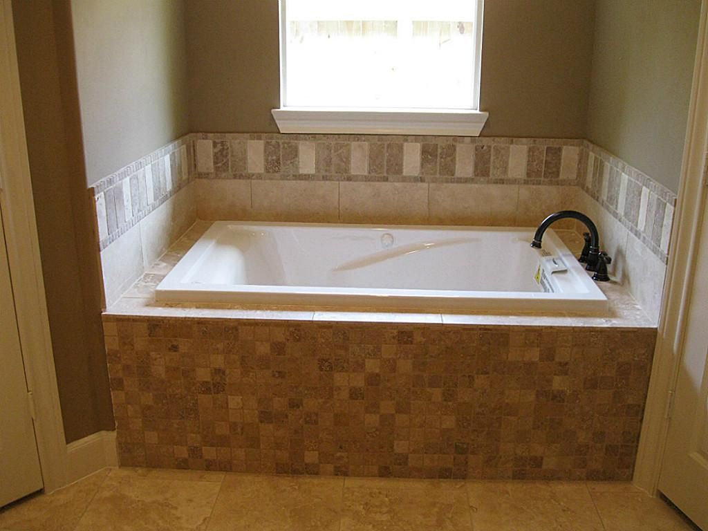 Whirlpool Tub With Custom Travertine Tile Work And Oil