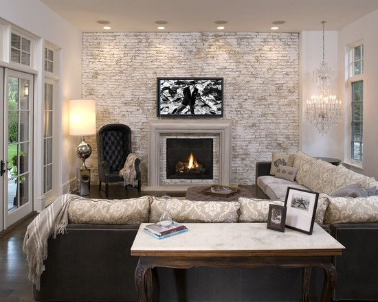 white washed brick living room wall +john kraemer & sons in