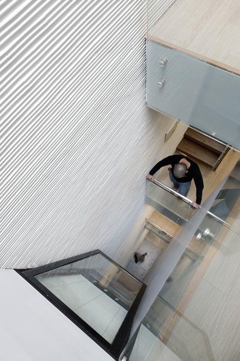 A narrow atrium brings daylight into windowless rooms on