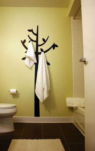 Great idea!  Paint a tree on the wall, add hooks, hang towels.