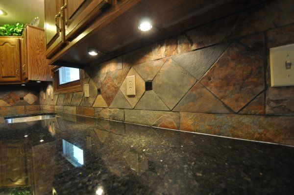 This is an elegant slate tile backsplash with some great pattern