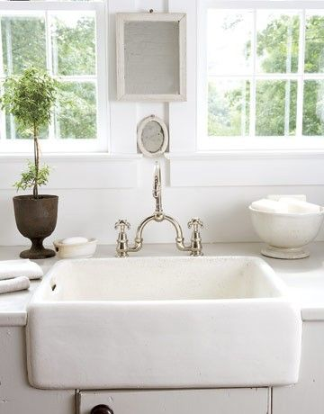 Love the white tub sink and faucet..