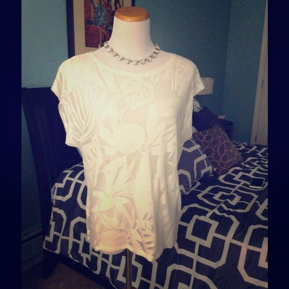 Sheer Off-White Tee This sheer off-white tee has a beautiful palms design that makes this the perfect vacation piece for your kid-winter vacation. This can be worn with a camisole or over a bathing suit as a partial cover-up. New with tags, never worn GAP Tops Tees - Short Sleeve