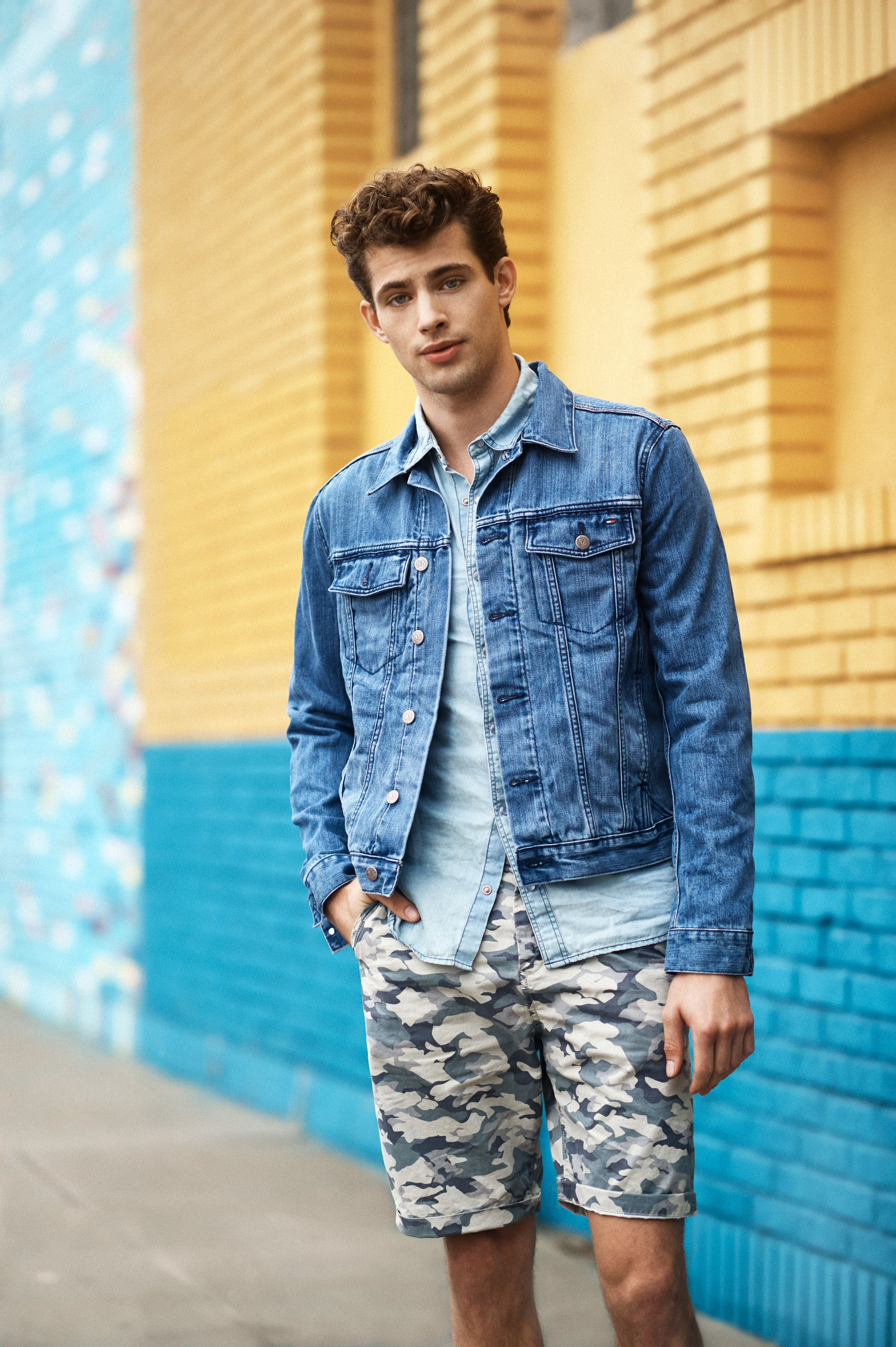 26eec19c3bca6 Summer's camo shorts look perfect when worn with a chambray shirt and a  great denim jacket #TommyHilfiger