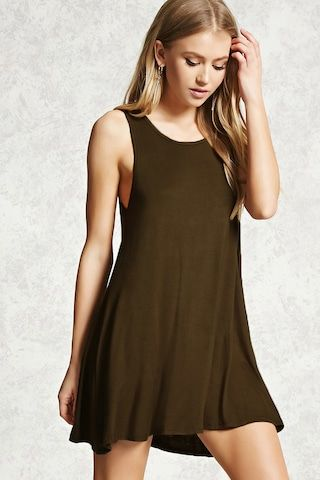 A knit mini dress featuring a swing silhouette, a strappy crisscross back, and a sleeveless cut.