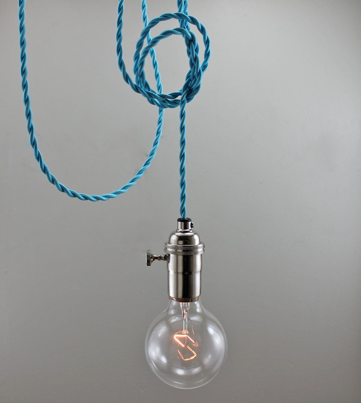 bright blue bare bulb pendant lighting a baby room