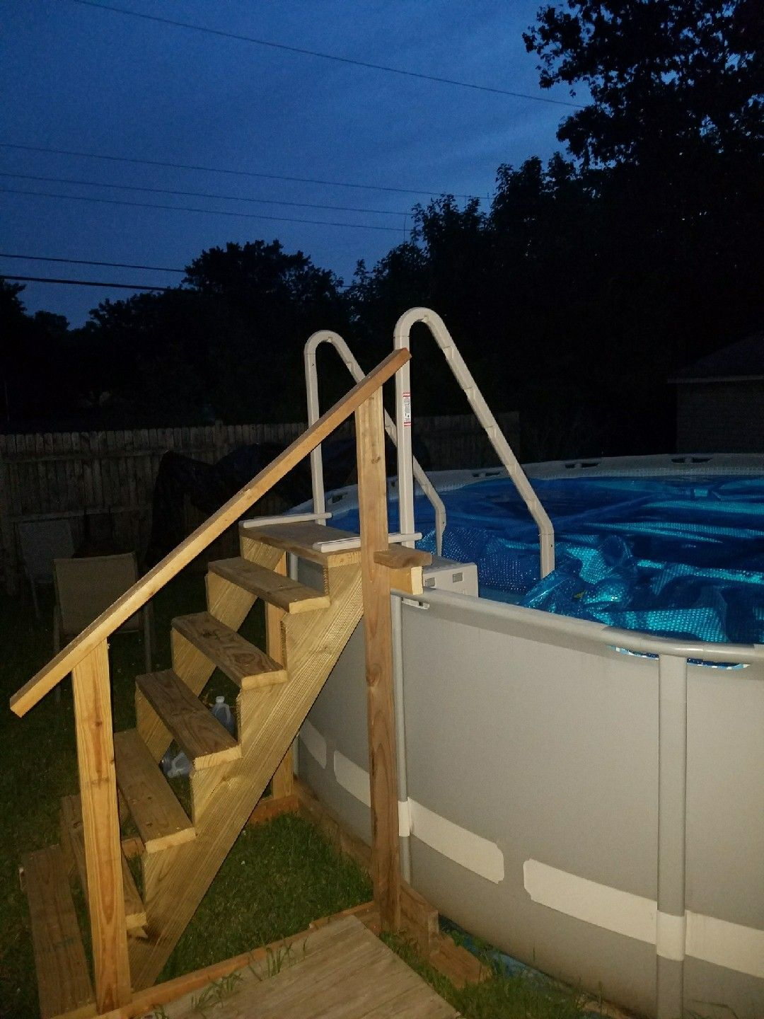 I Built Stairs For Our Pool With Confer Steps Attached For Easy Entry And Exit Love Them Works Grea Backyard Pool Pool Deck Plans Backyard Pool Landscaping