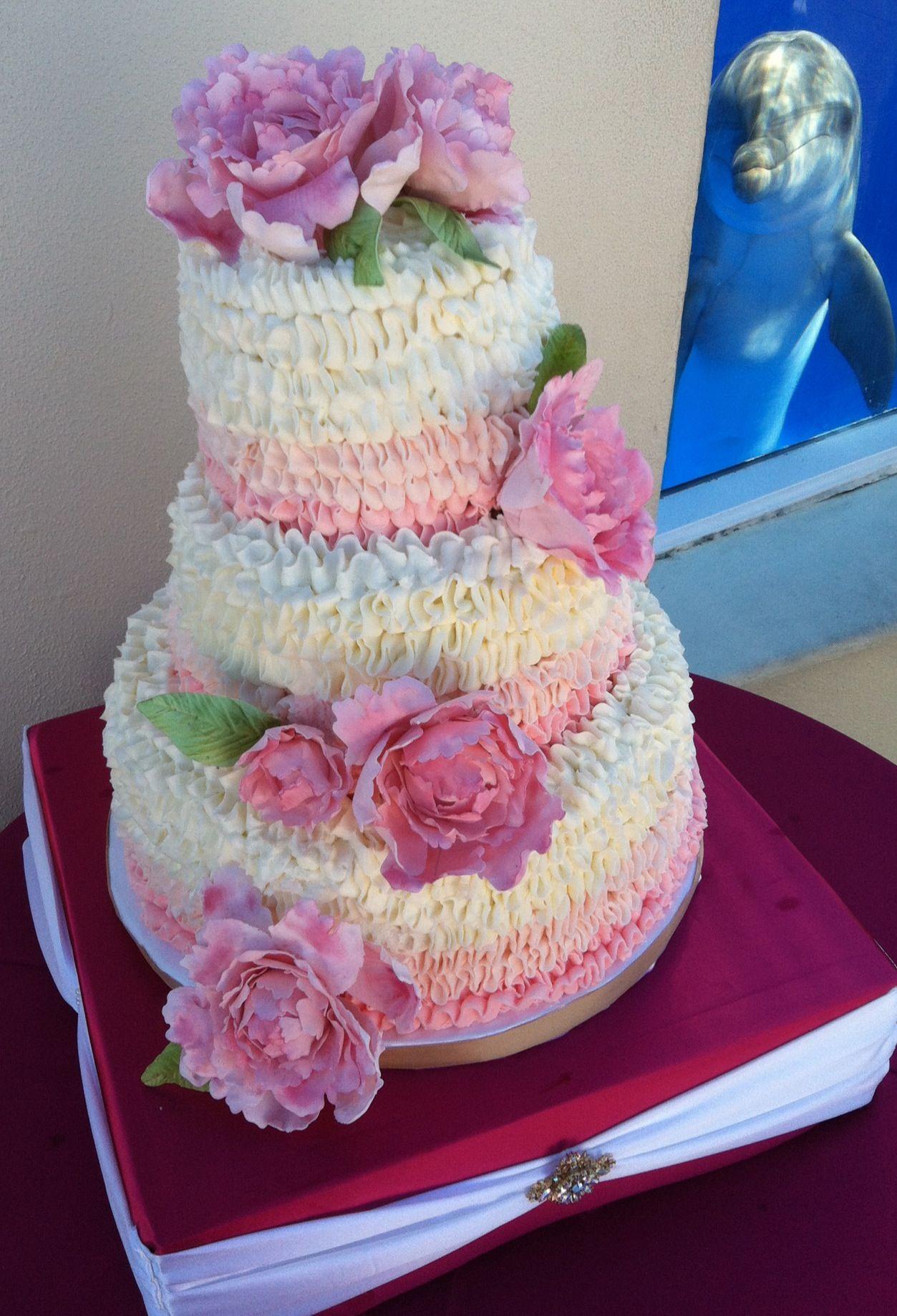 Pink ruffle wedding cake with gumpaste peonys with