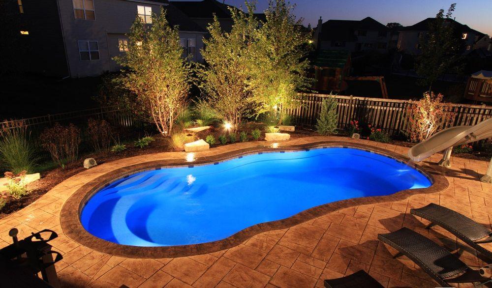 Riviera fiberglass pool at night hardscape for pool - Riviera fiberglass pools ...