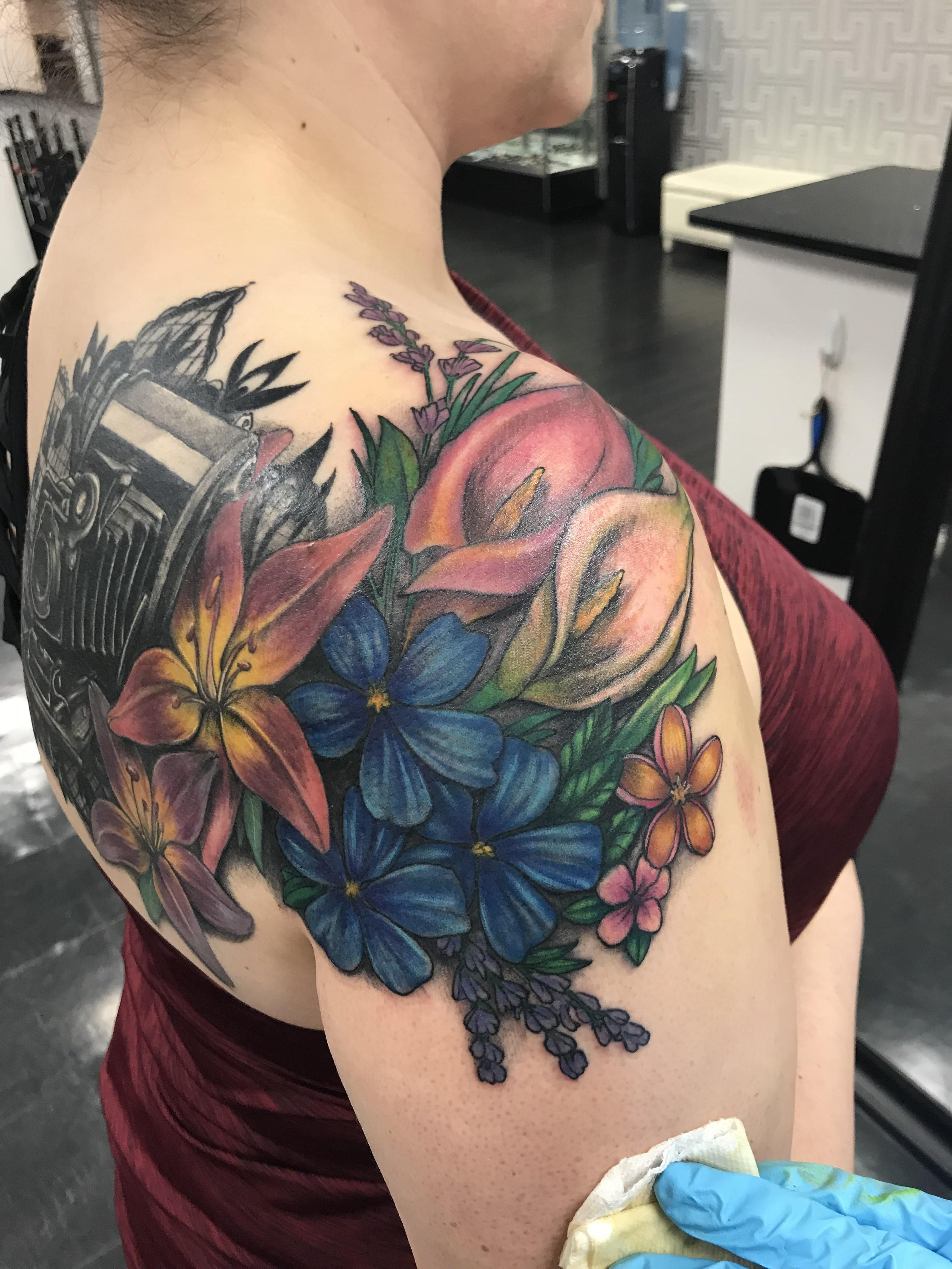 Added more flowers to the camera tattoo artist hayley