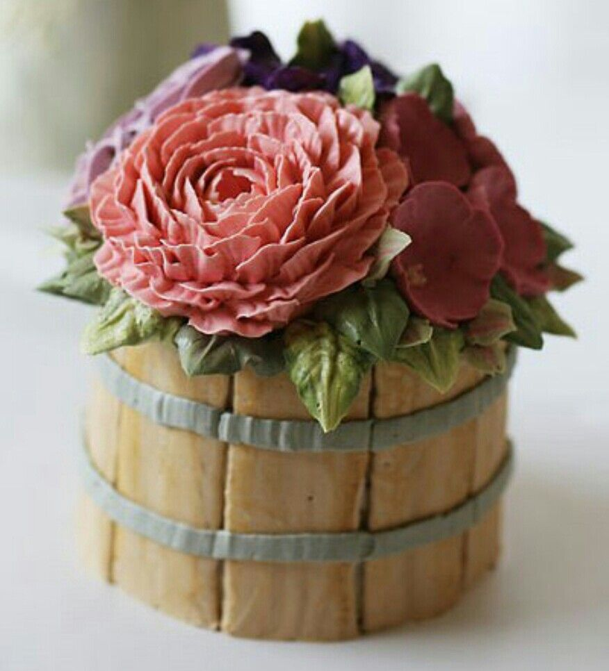 This is all buttercream! A lovely, elegant, country cake of piped flowers in a wooden barrel...so much talent involved!