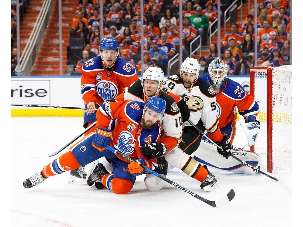 Kris Russell heads this Edmonton Oilers vs Anaheim Ducks super photo.