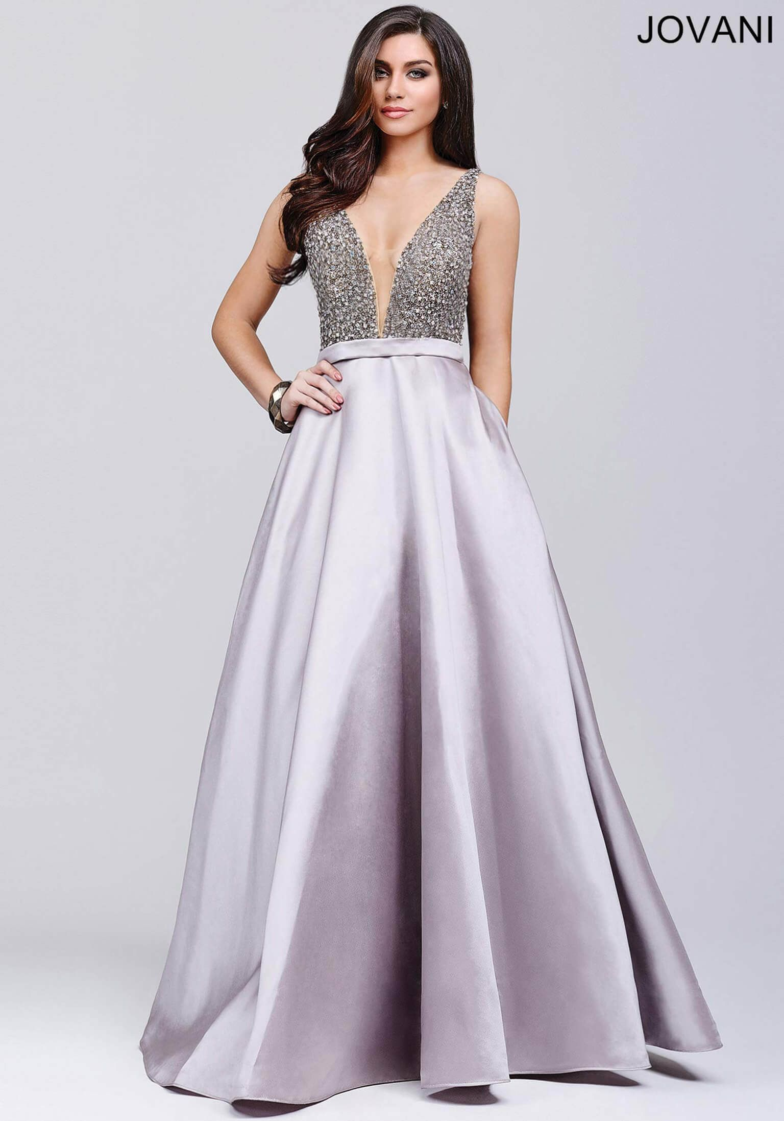 floor length ballgown with a plunging sheer mesh neckline