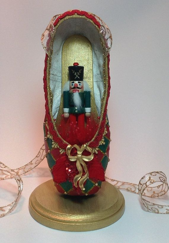 OOAK harlequin pattern in red and green with glittery gold trim, all covered with tiny gold sparkles, and a small Nutcracker tucked into the toe.