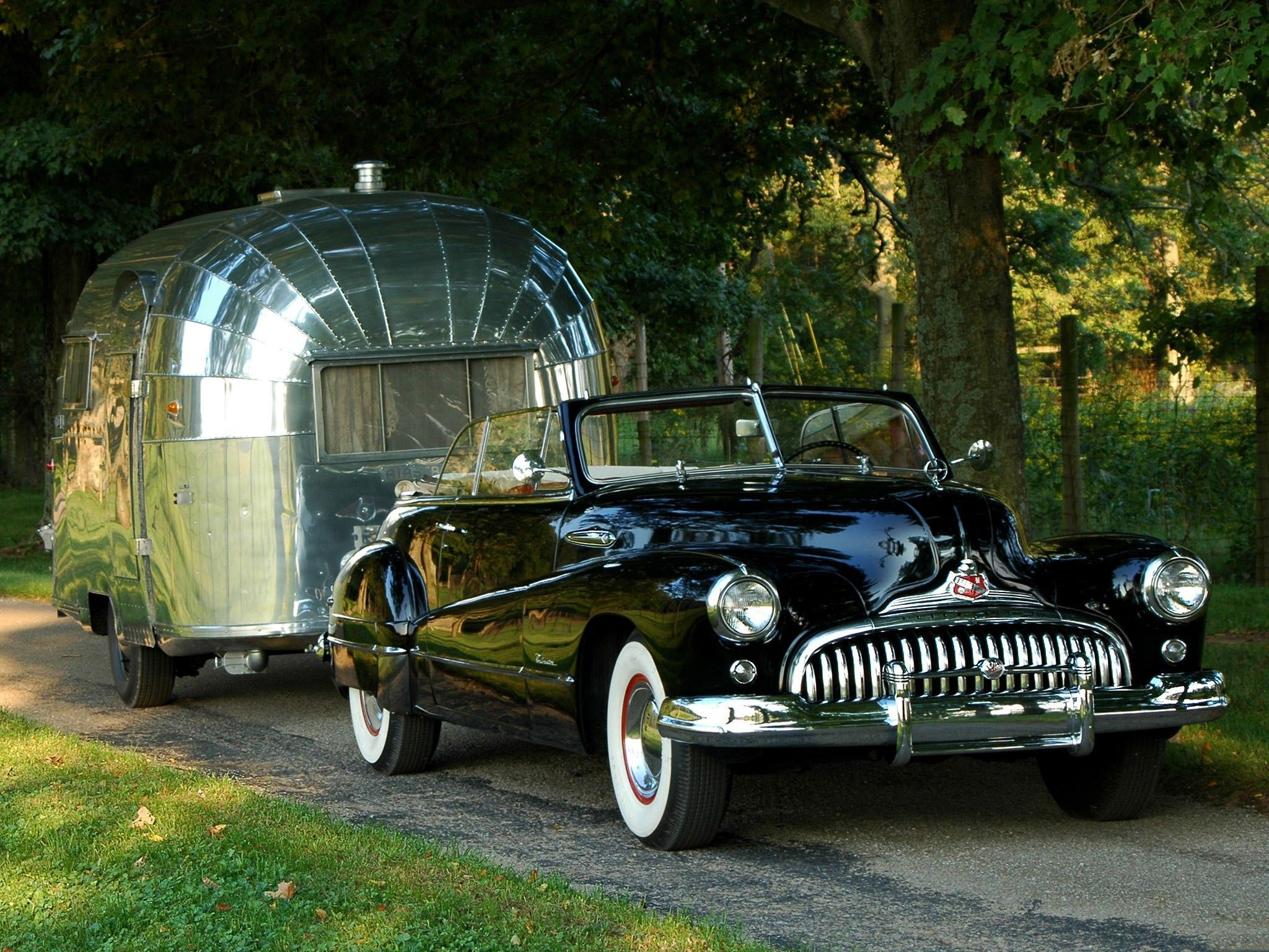 Old Buick convertible pulling an Airstream trailer. Hard to get ...