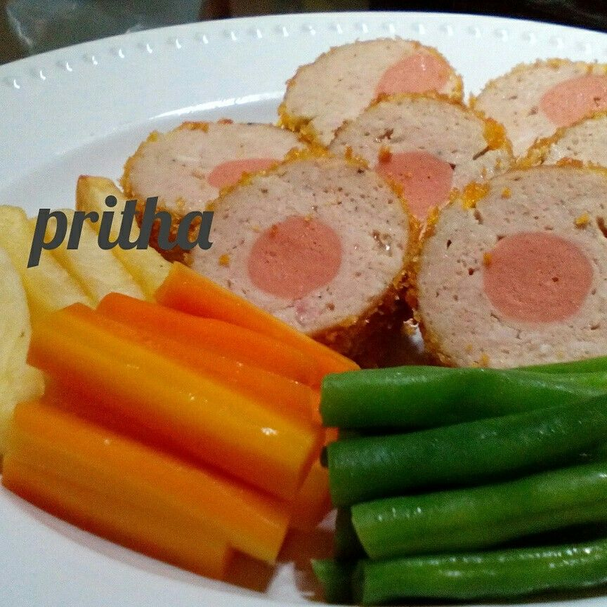 Galantine : Ground chicken, Eggs, Bread soaked in milk, Garlic, onion,salt, pepper, nutmeg ,Beef Sausage . Coated with egg and bread crumb.