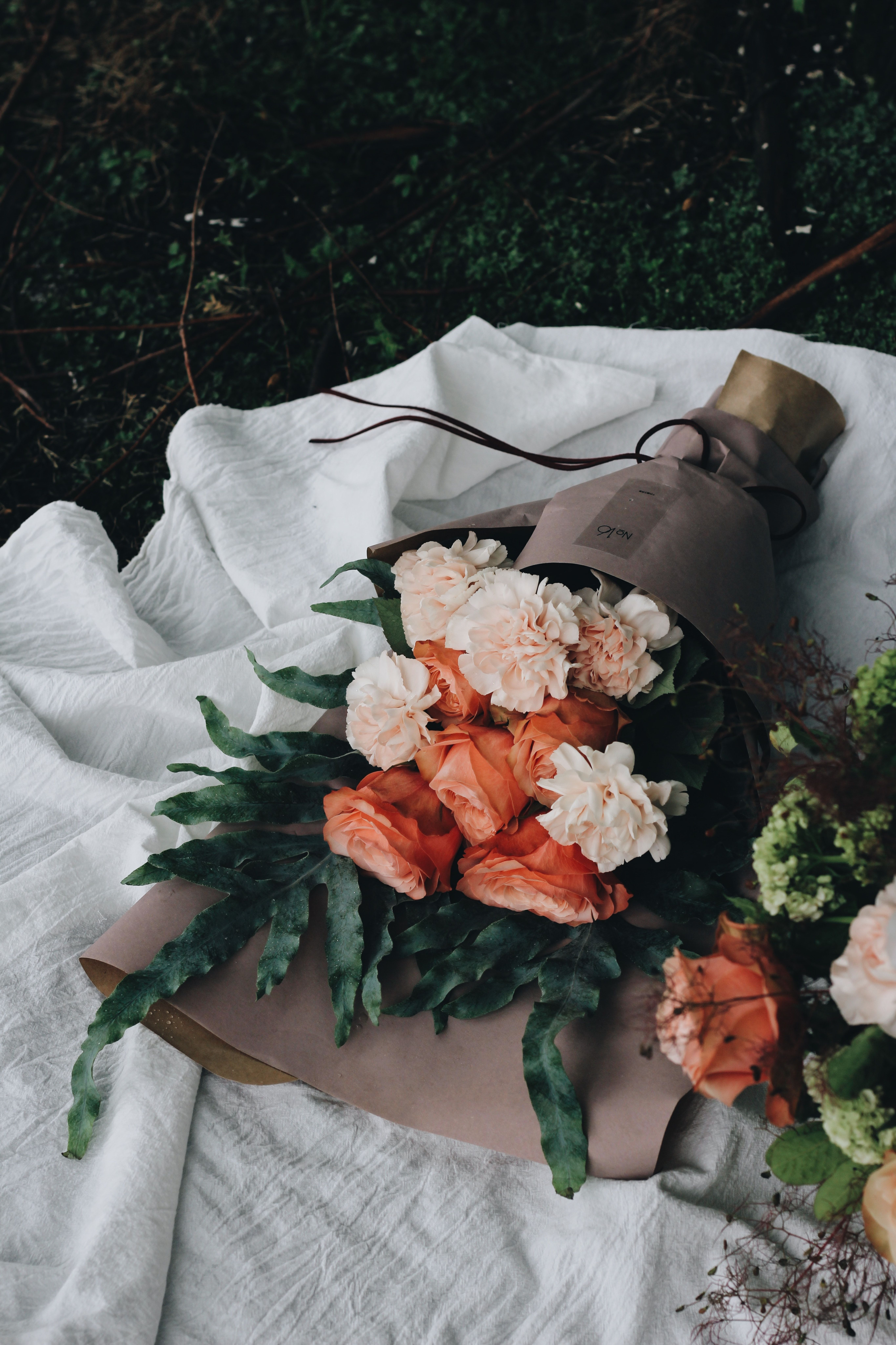 Large Bouquets Of Pink Carnations Wrapped In Paper And Laid Down On The Ground Carnation Bouquet Flowers Bouquet Flowers Bouquet Gift