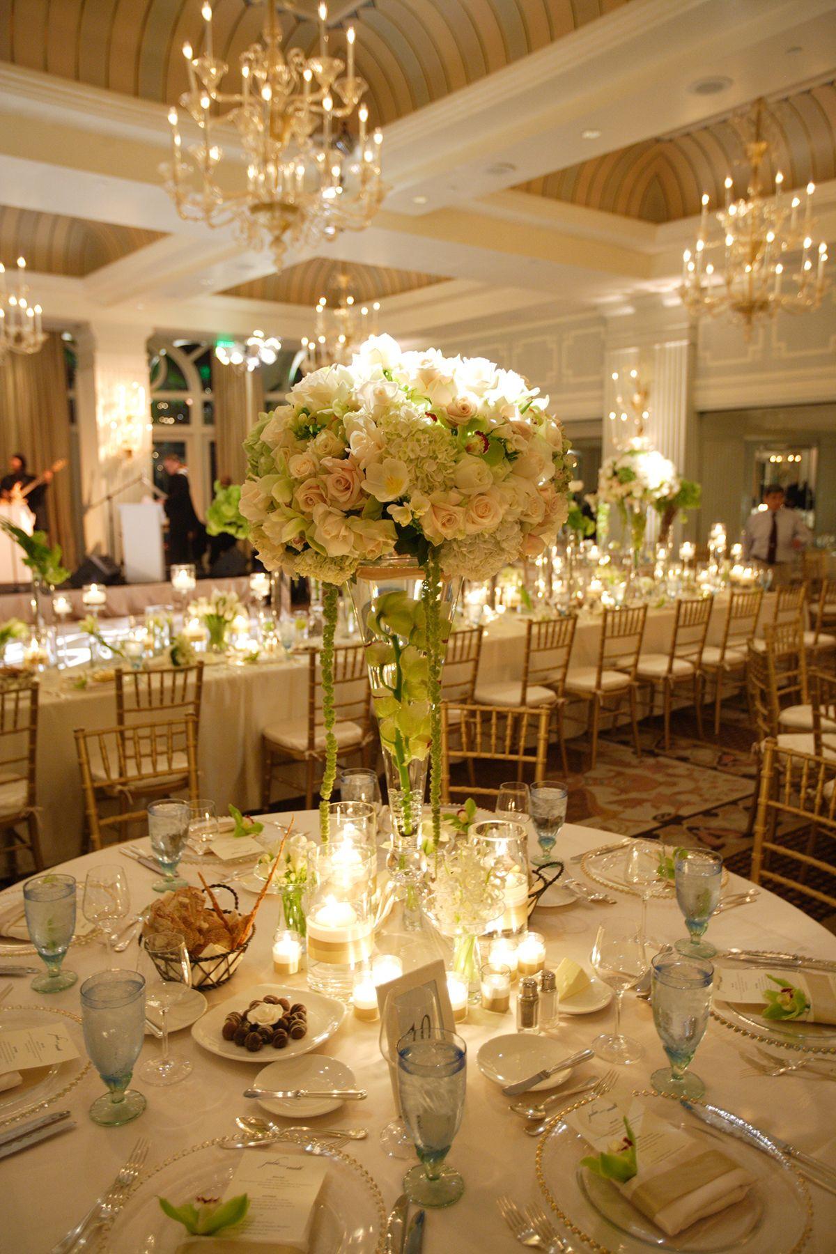 Beautiful wedding reception table setting. Colonnade
