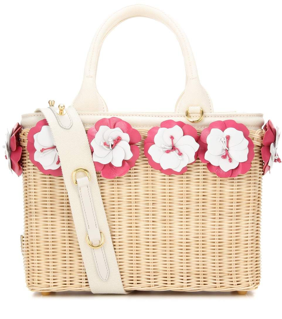 4bb91ce781b3 Update your summer edit with a charming Prada handbag. This wicker-basket  style has been crafted in Italy and comes with dimensional leather florals.