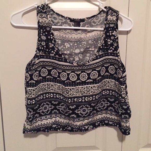 Cute patterned crop top NWOT Black & white patterned bohemian top. Pairs well with high rise skirts or shorts. And super cute over a bathing suit. Forever 21 Tops Crop Tops