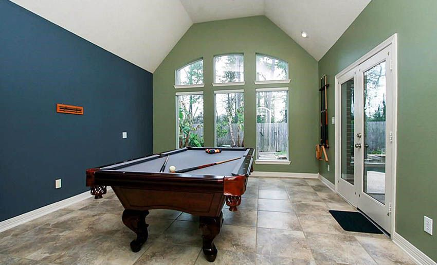Game Room With Green Wall Paint And Navy Blue Accent Wall Accent Wall Colors Accent Wall Colors Bedroom Wall Color Combination