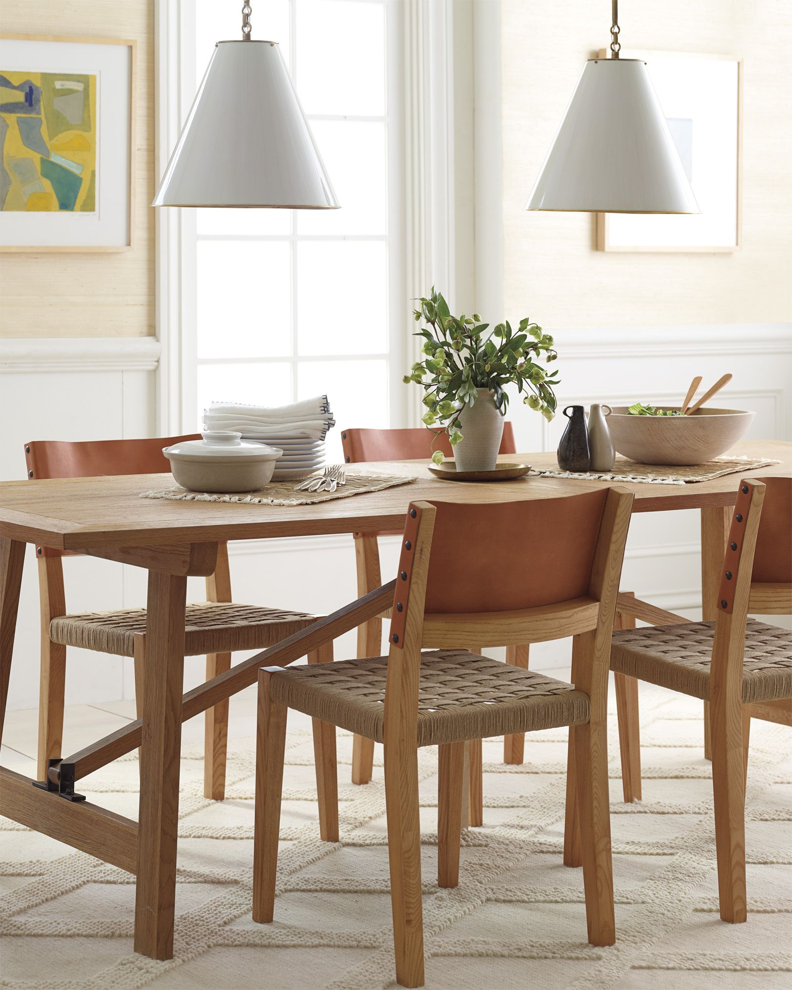 This Is Dining Room Inspiration We Love The Woven Chairs With Leather Back Textured Rug And Brass Light Pendants