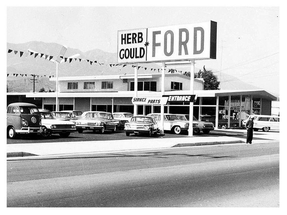 Early Covair on a car lot. Car dealership, Vintage cars
