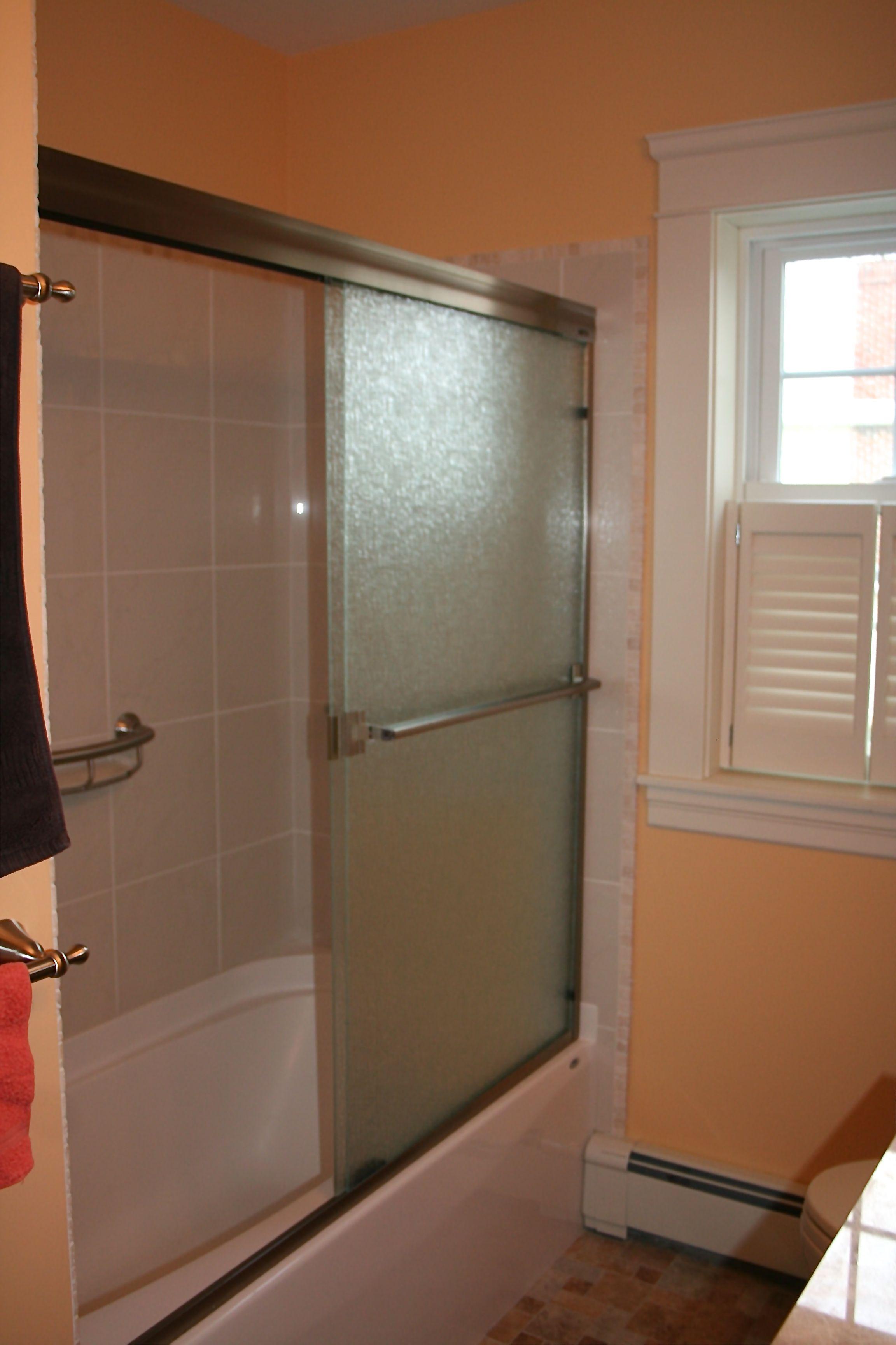 Aker bathtub,Basco Sliding door,Travertine tiled shower ...