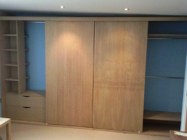 Wardrobe with oak veneer sliding doors plenty of mixed for Inside wardrobe storage