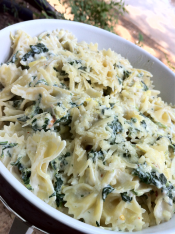 Spinach Artichoke Pasta. store: bowtie pasta/ reduced fat cream cheese/ milk/ reduced fat sour cream/ lemon/ can of artichoke hearts/ frozen spinach/