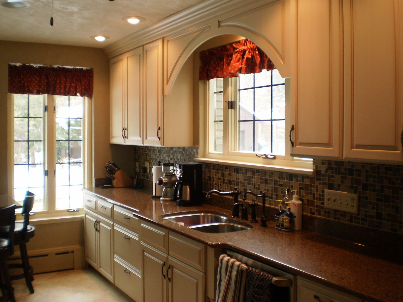Custom Omega Cabinetry In An Opaque Finish Bumped Out Sink Base And Arched Valance Above Window Kitchen Transformation Kitchen Kitchen Remodel